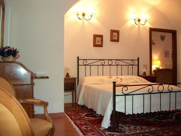 Villa Sant'Agnese, a bedroom of the suite